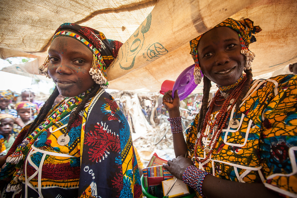 Two fulani girls wearing colourful garments and beads in Niger