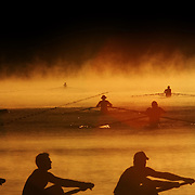 Rowers warm up at sunrise as the mist rises off the water at the Sydney International regatta Centre, Penrith, Australia, before the start of the  Australian Rowing Championships.
