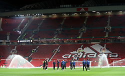 Derby County players inspect the pitch prior to the FA Cup, third round match at Old Trafford, Manchester.