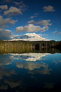 Mount Adams, one of five volcanoes in Washington state, is reflected in the relatively still waters of Takhlakh Lake in the Gifford Pinchot National Forest.