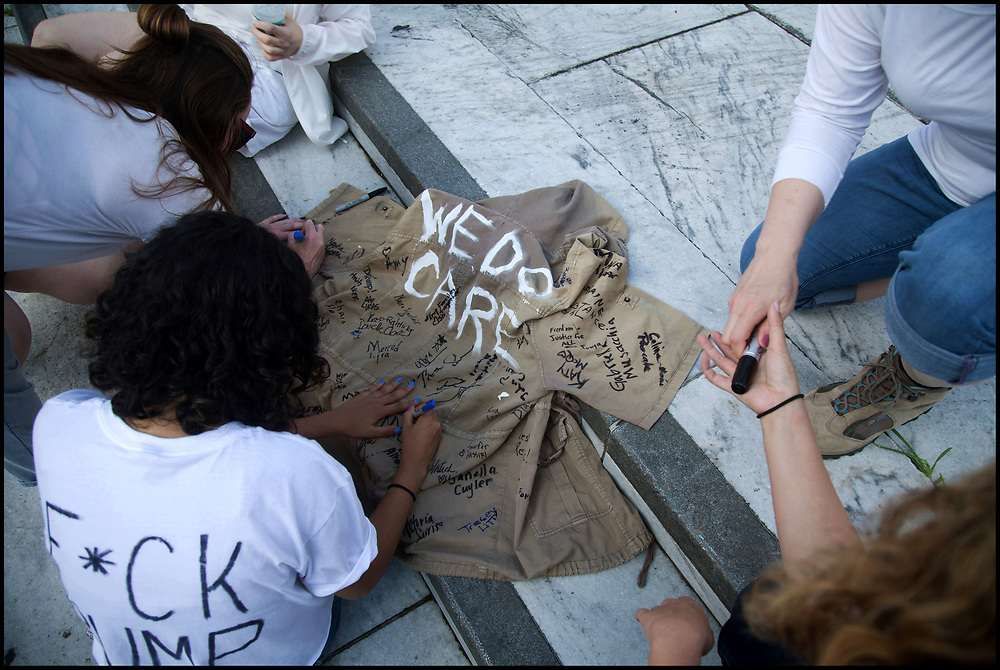 """On June 28, 2018 more than one thousand women from all over the US marched from the Freedom Plaza in Washington, DC, to Capitol Hill for a peaceful protest and sit-in at The Hart Senate Office Building over the Trump administration's """"zero tolerance"""" immigration policy which called for separating children from their parents. At least 575 women were arrested."""