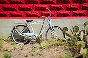 Bicycle at the historic red brick Three Rivers Schoolhouse, Three Rivers, New Mexico USA
