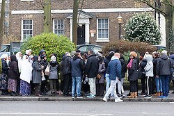 © Licensed to London News Pictures. 23/01/2019. London, UK. Local friends and neighbours gather to lay flowers on Forest Road, Walthamstow for 26 year old Luam Gebremariam who was involved in a fatal car accident with a police car responding to a 999 call last night.  Luam Gebremariam was a refugee from Eritrea and had been living at the YMCA Walthamstow near the scene of the accident for the last 18 months. Photo credit: Vickie Flores/LNP