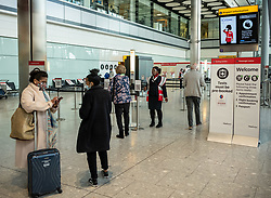 """© Licensed to London News Pictures. 09/04/2021. London, UK. Passengers queue up at a testing centre at at London Heathrow. Today, Transport Secretary Grant Shapps sets out details of the government's """"traffic Light"""" system for May 17th so that the public can travel abroad with passengers requiring to take a private covid-19 test each way, costing as much as £150.00 for one test. Photo credit: Alex Lentati/LNP"""