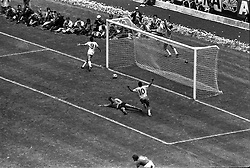 21 June 1970 - FIFA World Cup Final - Brazil v Italy - Tostao (9) and Pele (10) of Brazil run over to teammate Carlos Alberto (behind goal) to celebrate his goal.