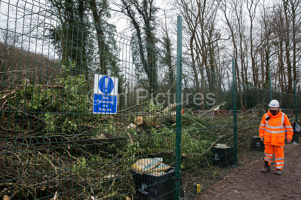 A HS2 security worker guards an area of woodland alongside Small Dean Lane currently being cleared for the high-speed rail link on 20th February 2021 in Wendover, United Kingdom. Anti-HS2 activists based at the nearby Wendover Active Resistance Camp continue to oppose the felling of the woodland.