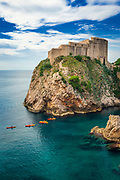 Lovrijenac Fortress and kayaks on the blue Adriatic, old town Dubrovnik, Dalmatian Coast, Croatia