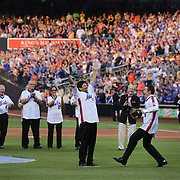 NEW YORK, NEW YORK - May 28: D.J. Carter and Jesse Orosco conclude the ceremony by recreating the final pitch of the '86 World Series during the anniversary celebration of the 1986 World Championship team before the Los Angeles Dodgers Vs New York Mets regular season MLB game at Citi Field on May 28, 2016 in New York City. (Photo by Tim Clayton/Corbis via Getty Images)