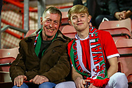 A father and son who had come to watch the Friendly European Championship warm up match between Wales and Trinidad and Tobago at the Racecourse Ground, Wrexham, United Kingdom on 20 March 2019.