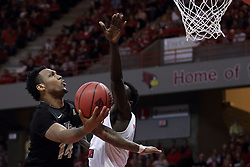 """20 March 2017:   Nick Banyard elevates over Daouda """"David"""" Ndiaye (4) during a College NIT (National Invitational Tournament) 2nd round mens basketball game between the UCF (University of Central Florida) Knights and Illinois State Redbirds in  Redbird Arena, Normal IL"""