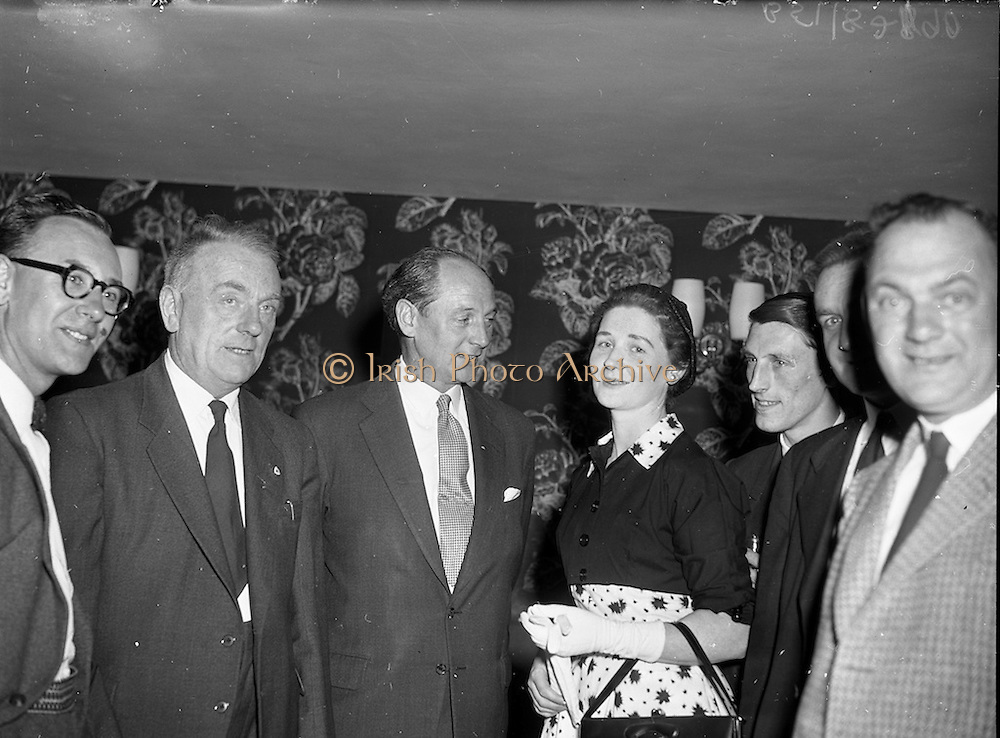 """27/05/1959<br /> 05/27/1959<br /> 27 May 1959<br /> Presentation of Esso Perpetual Trophy to the Listowel Drama Group at the Shelbourne Hotel, Dublin. The trophy and replicas for the  All Ireland Amateur Dram festival were presented by Mr. T.F. Laurie, Chairman and Managing Director of Esso Petroleum Co. (Ireland) Ltd. at a special luncheon. The Listowel group won the competition with their performance of the 3 Act play """"Sive"""" by John B. Keane. Picture shows chatting at the reception before the presentation (l-r): William Kearney, cast member;  Deputy Dan Moloney T.D. for Kerry North; Mr jack Lynch T.D., Minister for Education and Miss Nora Relihan, cast member."""