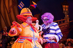 """© Licensed to London News Pictures. 08/12/2011. London, England. L-R: Eric Potts as Sarah the Cook and Barry Humphries as Dame Edna Everage - Saviour of London. Dick Whittington panto starring Dame Edna Everage (Barry Humphries) as the """"Saviour of London"""" opens at the New Wimbledon Theatre, London. The show, written and directed by Eric Potts is scheduled to run to 15 January 2012. Photo credit: Bettina Strenske/LNP"""
