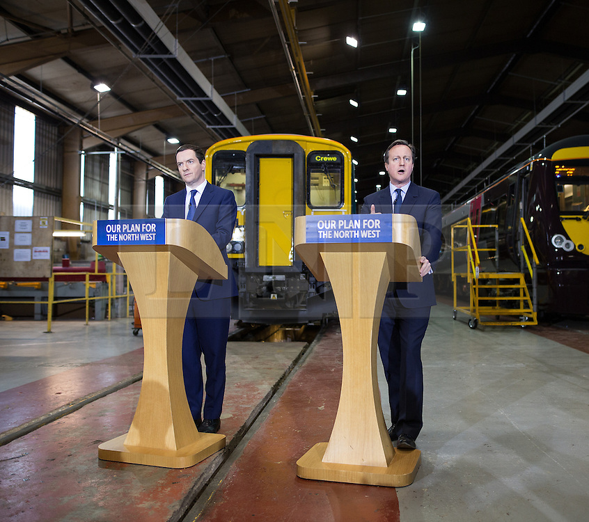 © Licensed to London News Pictures . 20/04/2015 . Crewe , UK . George Osborne and David Cameron speaking in an Arriva train shed in Crewe , Cheshire as part of the Conservative Party's election run . Photo credit : Joel Goodman/LNP