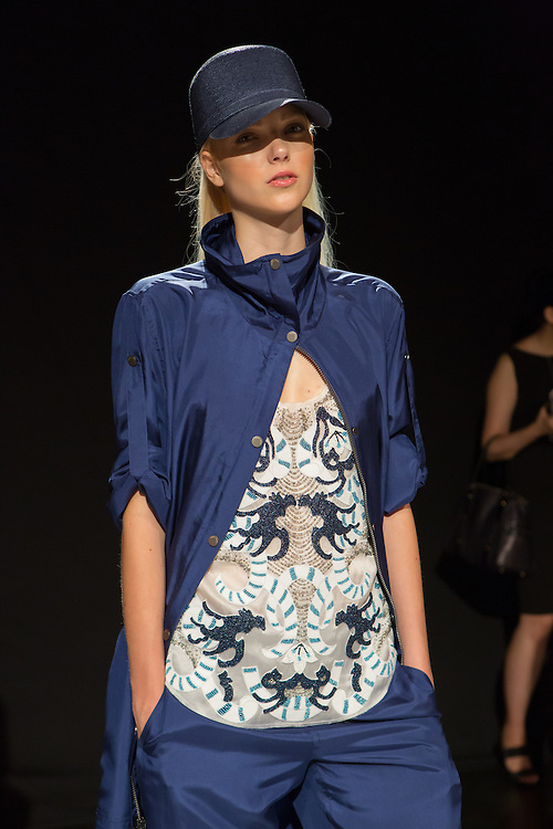 A finely beaded top under a loose blue jacket with matching trousers. By Monika Chiang at Spring 2013 Fashion Week in New York.