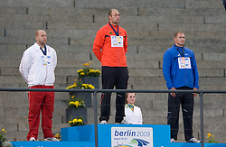 (FromL) Poland's Piotr Malachowski, Germany's Robert Harting and Estonia's Gerd Kanter celebrate during the men's discus throw medal ceremony of the 2009 IAAF Athletics World Championships on August 20, 2009 in Berlin. Germany's Robert Harting won the gold, Poland's Piotr Malachowski the silver and Estonia's Gerd Kanter the bronze. (Photo by Vid Ponikvar / Sportida)