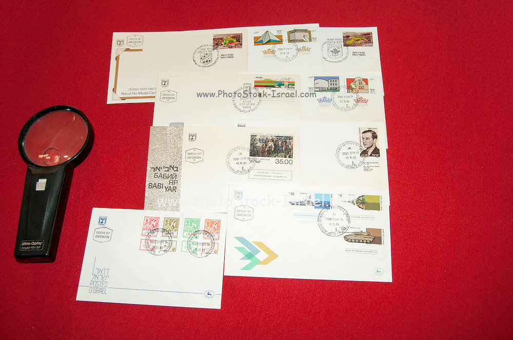 Stamp collection a set of Israeli First Day Covers from 1983 with magnifying glass