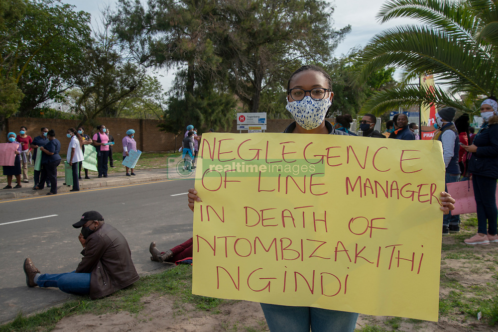 """""""I tested positive,"""" says Jemimah Mokubunge, on Friday, June 5, 2020, holding a (health-union SAFTU) sign that alleges that Tygerberg nurse Ntombizakithi Ngidi, who died of COVID-19 related illness, was initially refused medical care by her superiors. <br /> Mokubunge is a clerk handling patients' hospital records. """"Sometimes we get coronavirus patients' records,"""" she said. """"And there was no sanitizer. Most of the people (in the department) got positive.""""<br /> When the first person in her department contracted the virus, that employee was the one to notify her colleagues by calling them from isolation, explains Mokubunge. """"We asked to be tested,"""" she said. But """"they refused us to get tested."""" <br /> """"Only when the second person tested positive were we allowed to get tested,"""" she said. """"I tested positive. I did not feel sick."""" <br /> Mokubunge lives with her husband, mother and nine-month old baby. """"They said I could isolate with the baby,"""" she said she was advised by the health professionals.  <br /> After quarantining at home for 14 days, Mokubunge was told to go back to work. No retesting was available, she said. Her family tested negative for the virus. <br /> Hospital workers demonstrate outside Tygerberg Hospital, in Cape Town, to bring their plight to the attention of President Cyril Ramaphosa, as he visited the Cape Town Province. PHOTO: EVA-LOTTA JANSSON"""