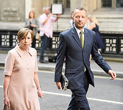 © Licensed to London News Pictures. 18/07/2018. London, UK. JONATHAN MUNRO (right), Head of Newsgathering at the BBC arrives at the Rolls Building of the High Court in London where judges will deliver their decision on a claim by Sir Cliff Richard for damages against the BBC for loss of earnings. The 77-year-old singer is suing the corporation after his home in Sunningdale, Berkshire was raided following allegations of sexual assault made to Metropolitan Police. Photo credit: Ben Cawthra/LNP