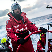 Leg 7 from Auckland to Itajai, day 06 on board MAPFRE, Guillermo Altadill steering at the sunset. 23 March, 2018.