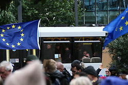 © Licensed to London News Pictures. 02/10/2021. Manchester, UK.  People watch from a tram as anti-Brexit demonstrators gather in Manchester city centre. Pro-EU groups came together in Manchester to demand that the UK return to the single market and customs union and reinstate freedom of movement for workers.  Photo credit: Adam Vaughan/LNP