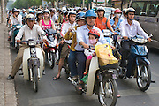 Motorcyclists waiting at a red light in downtown Ho Chi Minh City (Saigon), Vietnam.