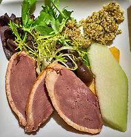 Smoked Duck Breast, Greens, and Mellon Salad. Image taken with a Fuji X-T3 camera and 35 mm f/1.4 lens (ISO 800, 35 mm, f/2.8, 1/50 sec).