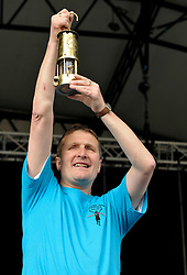 © Licensed to London News Pictures. 25/08/2012. Bath, UK. Double Paralympic Gold Medallist Steve Brunt with the Paralympic Flame in a lantern onstage at Bath Recreation Ground for a celebration prior to the start of the Paralympic Games 2012.  25 August 2012..Photo credit : Simon Chapman/LNP