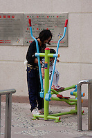 woman with child playing with exercise equipment in Shanghai China