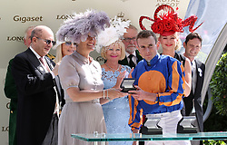 Sophie Countess of Wessex presents winning jockey Ryan Moore with the an award for winning the Ribblesdale Stakes on Magic Wand during day three of Royal Ascot at Ascot Racecourse.
