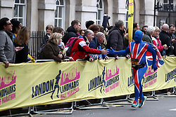 A Runner interact with the crowd as the come towards the finish line of the 2018 London Landmarks Half Marathon. PRESS ASSOCIATION Photo. Picture date: Sunday March 25, 2018. Photo credit should read: John Walton/PA Wire