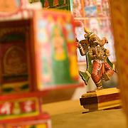 A wooden artifact of the God Ganesha among other wooden work at KAMALA craft shop at the Rajiv Gandhi Handicrafts emporium at Baba Karnak Singh Marg, New Delhi.