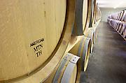American oak barrel. Oak barrel aging and fermentation cellar. Chateau Saint Christoly, Medoc, Bordeaux, France