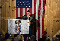 Pete Buttigieg receives well wishes and support from Pat Provencher during his 2020 Barn Party in New Hampton on Saturday afternoon.  (Karen Bobotas/for the Laconia Daily Sun)