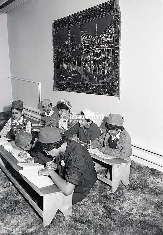 Children reading the Koran, mosque, Forest Fields, Nottingham UK 1985