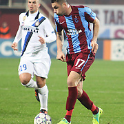 Trabzonspor's Burak YILMAZ (R) during their UEFA Champions League group stage matchday 5 soccer match Trabzonspor between Inter at the Avni Aker Stadium at Trabzon Turkey on Tuesday, 22 November 2011. Photo by TURKPIX