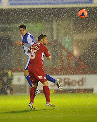 Bristol Rovers' Oliver Norburn wins a header against Crawley Town's Dannie Bulman - Photo mandatory by-line: Seb Daly/JMP - Tel: Mobile: 07966 386802 18/12/2013 - SPORT - FOOTBALL - Broadfield Stadium - Crawley - Crawley Town v Bristol Rovers - FA Cup - Replay