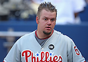 ATLANTA - JUNE 30:  Pitcher Joe Blanton #56 of the Philadelphia Phillies takes a breather in the dugout before the game against the Atlanta Braves at Turner Field on June 30, 2009 in Atlanta, Georgia.  The Braves beat the Phillies 5-4 in 10 innings.  (Photo by Mike Zarrilli/Getty Images)