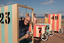Community arts event Art Walk Porty got underway this afternoon with a promenade procession of the event's 'Art Carts'. The carts, designed to echo the old style bathing carts that used to grace Portobello beach, will be used in a variety of ways by different artists at locations across Portobello, Edinburgh's seaside suburb. The Art Walk is now in its third year and will run over the next day days with a range of events and exhibitions.  Pictured: Artists Karl Stern, Rosy Naylor, Jill Martin Boualaxai and Jenny Martin.<br /> <br /> <br /> <br /> © Jon Davey/ EEm