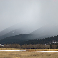 A spring storm hovers over a barn in Cottonwood Canyon of the Gallatin Range, near Bozeman, Montana.