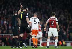 Blackpool's Paudie O'Connor (centre right) is shown a red card by referee David Coote during the Carabao Cup, Fourth Round match at the Emirates Stadium, London.