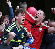 Boro fans celebrating the 1st goal during the Sky Bet Championship first leg play off match between Brentford and Middlesbrough at Griffin Park, London, England on 8 May 2015. Photo by Matthew Redman.