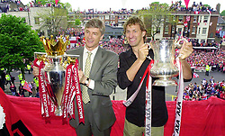 Arsenal's manager Arsene Wenger (left) and captain Tony Adams proudly hold the Premiership Trophy (with Wenger) and FA Cup, to thousands of their supporters.  THIS PICTURE CAN ONLY BE USED WITHIN THE CONTEXT OF AN EDITORIAL FEATURE. NO WEBSITE/INTERNET USE UNLESS SITE IS REGISTERED WITH FOOTBALL ASSOCIATION PREMIER LEAGUE.  *The club's squad went to Islington Town hall, to a civic reception where they showed off the two trophies which were won in the last week.    THIS PICTURE CAN ONLY BE USED WITHIN THE CONTEXT OF AN EDITORIAL FEATURE. NO WEBSITE/INTERNET USE UNLESS SITE IS REGISTERED WITH FOOTBALL ASSOCIATION PREMIER LEAGUE.