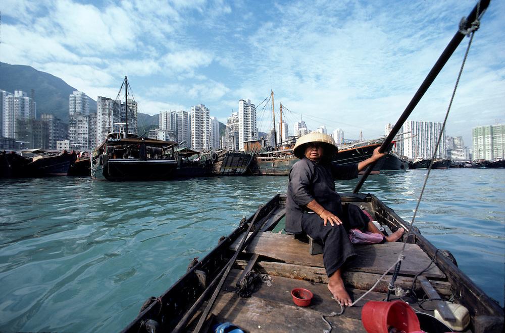 China, Hong Kong, Woman pilots small junk in Aberdeen Harbour