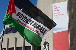"© Licensed to London News Pictures . 27/09/2015 . Brighton , UK . Palestinian flag with the words "" Boycott Israel "" on it outside the 2015 Labour Party Conference . Photo credit : Joel Goodman/LNP"