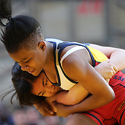 Girl wrestlers Amy Farusho, (left), New Jersey, in action against  Ronnie Green, New York City, during the 'Beat The Streets' USA Vs The World, International Exhibition Wrestling in Times Square. New York, USA. 7th May 2014. Photo Tim Clayton