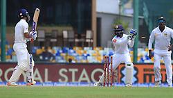August 4, 2017 - Colombo, Sri Lanka - Sri Lankan wicket keeper Niroshan Dickwella(2L)   removes the bails to dismiss Indian cricketer Ajinkya Rahane(L) during the 2nd Day's play in the 2nd Test match between Sri Lanka and India at the SSC international cricket stadium at the capital city of Colombo, Sri Lanka on Friday 04 August 2017. (Credit Image: © Tharaka Basnayaka/NurPhoto via ZUMA Press)