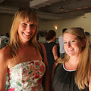 Amy Baxter, left, and Alissa Atkins pose for a photo during Fashion On Front Thursday August 21, 2014 at Bakery 105 in Wilmington, N.C.(Jason A. Frizzelle)