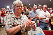 Aug, 25, 2009 -- SUN CITY, AZ: GRACE WAUGH and others applaud Sen John McCain during the Town Hall meeting on health care sponsored by Sen McCain at Grace Bible Church in Sun City, AZ, Tuesday. More than 1,000 people attended the meeting in the church, which seats 700. Sun City is a staunchly Republican suburb of Phoenix and most of the crowd was opposed to President Obama health care reform efforts. Photo by Jack Kurtz
