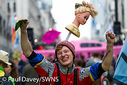 An impromptu rave is held with DJs aboard a yacht as hundreds of environmental protesters from Extinction Rebellion occupy Oxford Circus, a pink yacht being the focal point of their presence, with traffic denied access to two of London's busiest streets. London, April 16 2019.