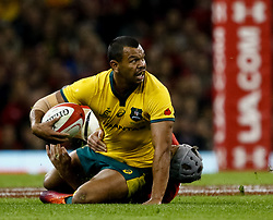 Kurtley Beale of Australia looks to offload<br /> <br /> Photographer Simon King/Replay Images<br /> <br /> Under Armour Series - Wales v Australia - Saturday 10th November 2018 - Principality Stadium - Cardiff<br /> <br /> World Copyright © Replay Images . All rights reserved. info@replayimages.co.uk - http://replayimages.co.uk